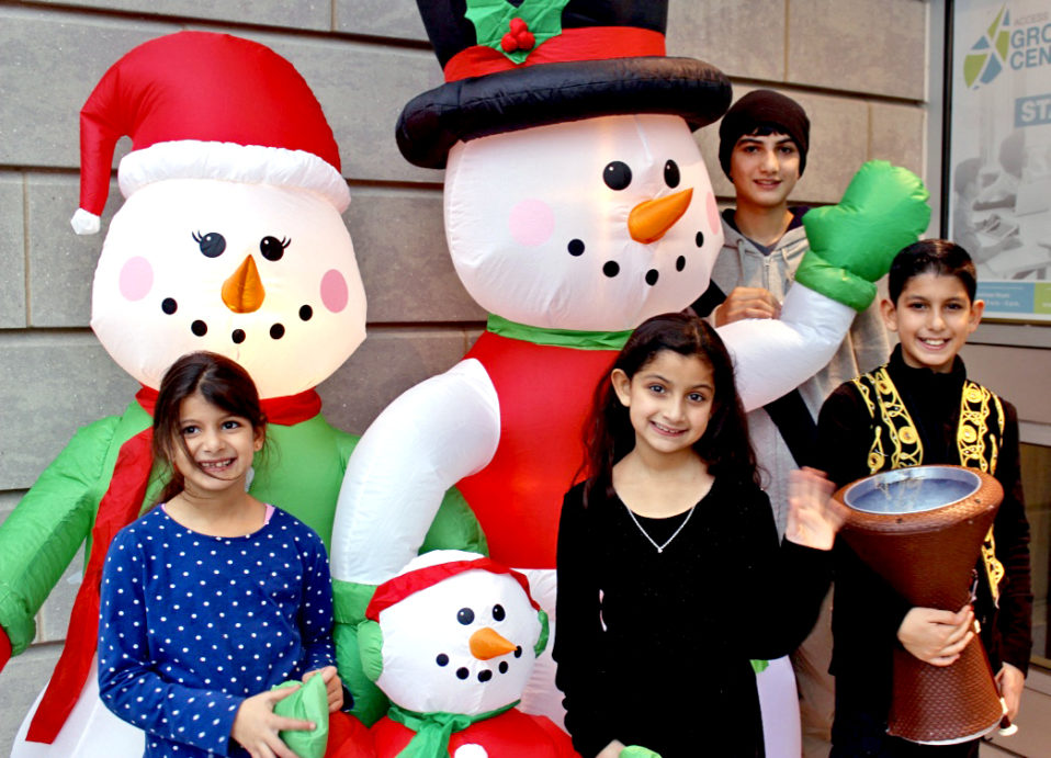 Kids with inflatable snowmen at the Christmas Party